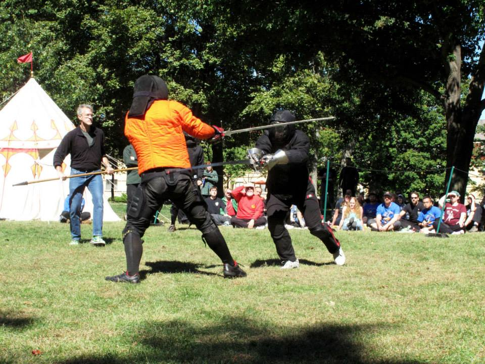 That's gotta hurt! A near-miss by Roland Cooper ends in his beheading by Mishael Lopes Cordoza during the longsword finals.